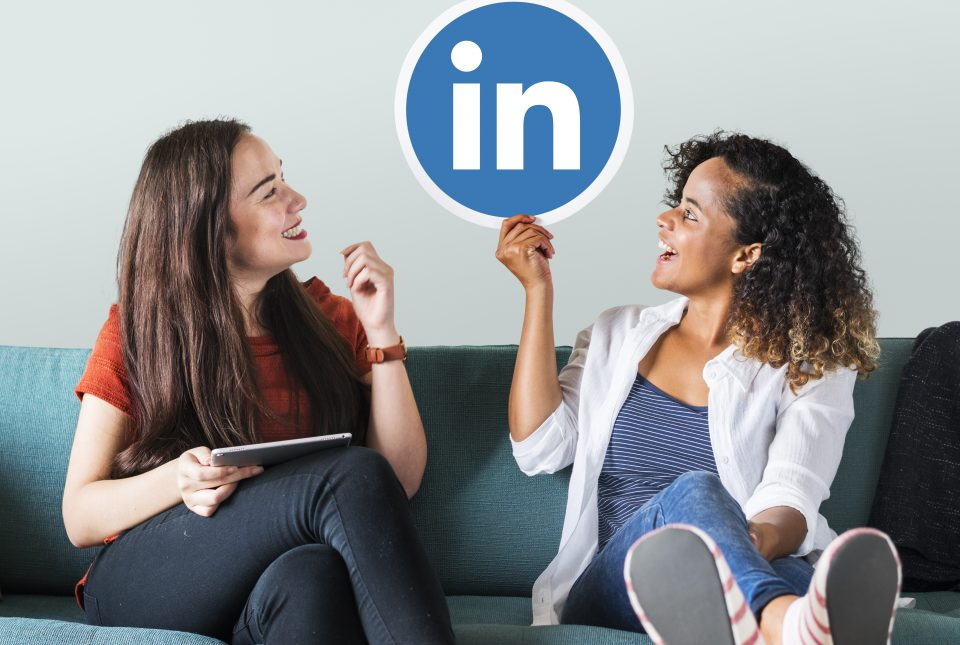 Women holding a Linkedin logo